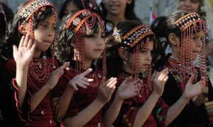 Yemeni girls take part in a fashion show held on 21 February in Sana'a to call for peace and an end of the ongoing war.
