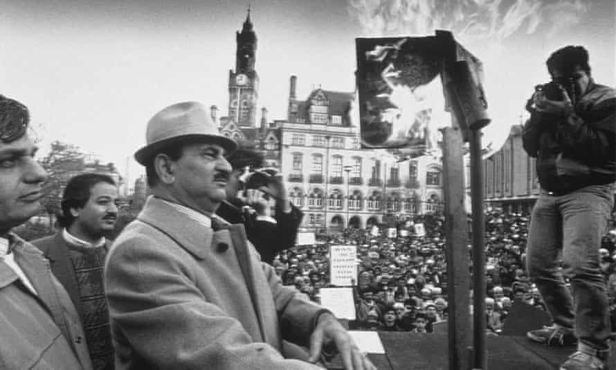 Demonstrators in Bradford, 1989, burning copies of Salman Rushdie's novel The Satanic Verses.