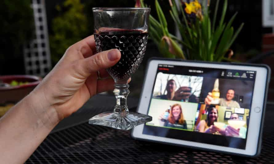 A woman lifts her glass and cheers with friends during a virtual happy hour amid the coronavirus crisis on 8 April 2020, in Arlington, Virginia.