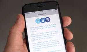 A customer using the TSB Online banking app on an iPhone reads a message about the IT problems