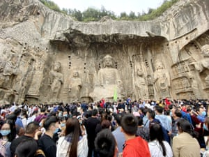 Tourists visit the Longmen grottoes in Luoyang, Henan province.