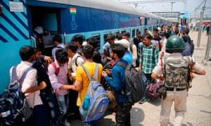 Non-Kashmiri students from Srinagar's National Institute board a train home in Jammu on Saturday.