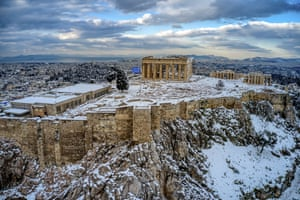 Athens, Greece: The Acropolis covered with snow after a heavy fall in February.