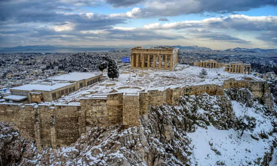 The ancient Acropolis hill in Athens covered with snow.
