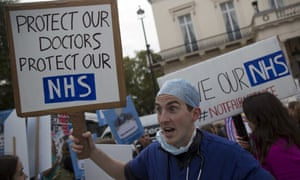 Protesters with placards: 'Protect our doctors, protect our NHS'