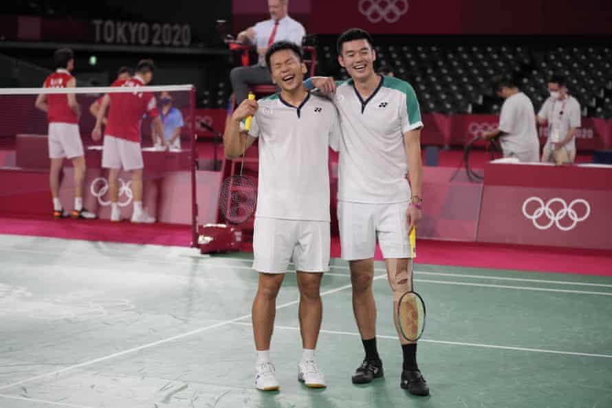 Taiwan's Wang Chi-Lin, right, and Lee Yang celebrate.