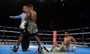 Eric Hunter knocks down Lee Selby during their IBF featherweight world championship bout.