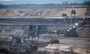 Bucket wheel excavators dig into the earth at the Garzweiler open pit lignite mine in western Germany
