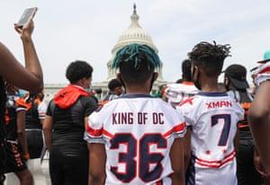 Children attend a protest in Washington DC on Saturday