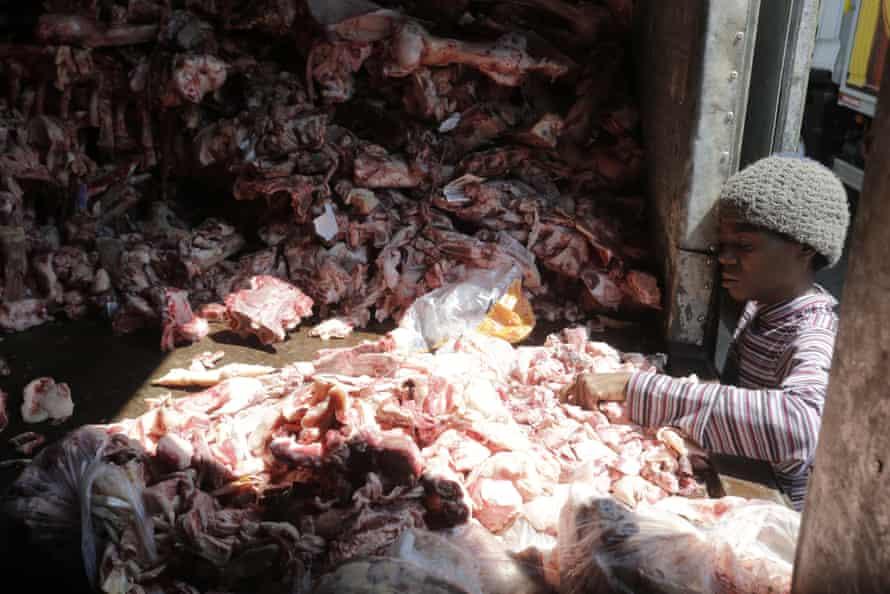 A woman scavenges through through animal carcasses for food in Rio de Janeiro.