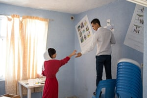 Teenagers decorate a classroom in Tehran, Iran.