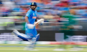India's Virat Kohli runs during the match against Pakistan at Old Trafford.