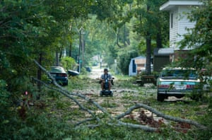 Branches litter an alley as a result of a hurricane in Virginia Beach, VA.