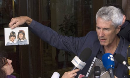 Anthony Foster, shown with pictures of his daughters Emma and Katie, both abuse victims, in March 2016 after a meeting with Cardinal George Pell in Rome.