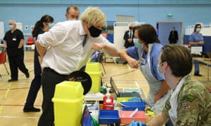 Boris Johnson visits a vaccination centre at Cwmbran Stadium, Wales, 17 February 2021.