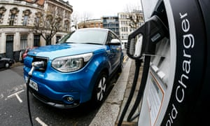 Ultra low electric vehicle on charge on a London street