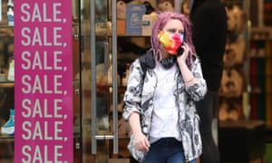 A shopper in Glasgow on 10 July, when face masks became mandatory in stores in Scotland.