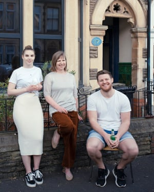 Manon Evans, Eva Trier and Greg Caine outside a house on Northumberland Street, Cardiff
