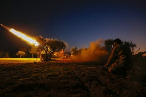 A rebel fires a rocket towards regime forces' positions in the southern countryside of Syria's Aleppo province.
