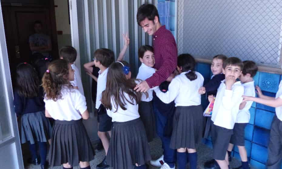 Villarreal's Manu Trigueros with children at the school where he completed his teacher training.