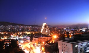 Surface-to-air missiles are seen over Syria's capital Damascus