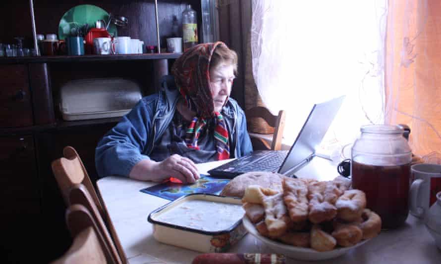 Anastasia Fedosenko showing archival photos.