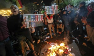 Supporters of the Bolivian opposition candidate Carlos Mesa of Comunidad Ciudadana party burn ballots during a protest in La Paz.