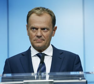 European Council President Donald Tusk listens during a press confenrence after the 17-hour Euro Summit at the EU headquarters in Brussels, Belgium, July 13, 2015.