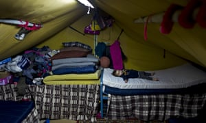 Syrian refugee Elan Darwish, 14 months, sleeps inside his family's tent in Kalochori refugee camp on the outskirts of Thessaloniki