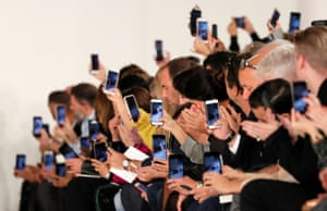 Mobile phones out in force during British designer John Galliano Spring/Summer 2018 show.