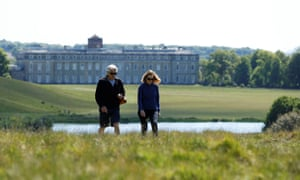 People take a walk in Petworth House and Park, following the outbreak of the coronavirus disease.