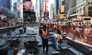 Workers repair the road in Times Square, New York City