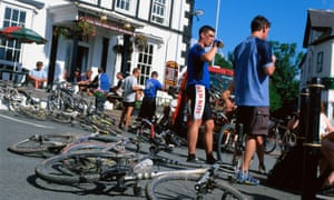 Mountain bikers relaxing in Llanwrtyd Wells outside the Neuadd Arms.