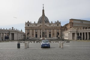A police car is parked inside an empty St. Peter's Square after the Vatican erected a new barricade at the edge of the square, in Rome, Tuesday, March 10, 2020.