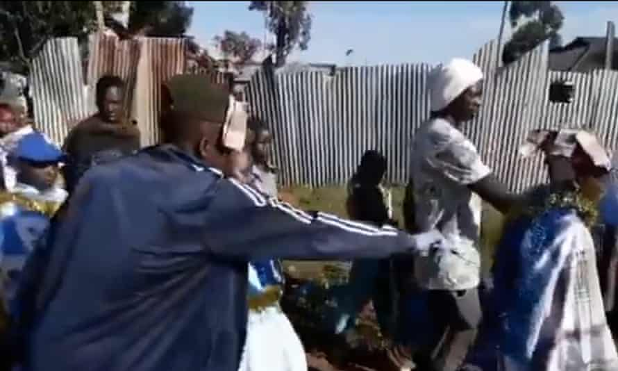 A still from a video posted on Twitter showing girls who have undergone FGM being paraded through the street