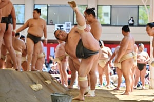 Tokyo, Japan: Sumo wrestlers take part in a 'honozumo', a ceremonial sumo exhibition, on the grounds of the Yasukuni shrine