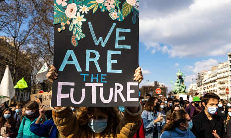 Demonstrators in Paris march for climate and social justice.