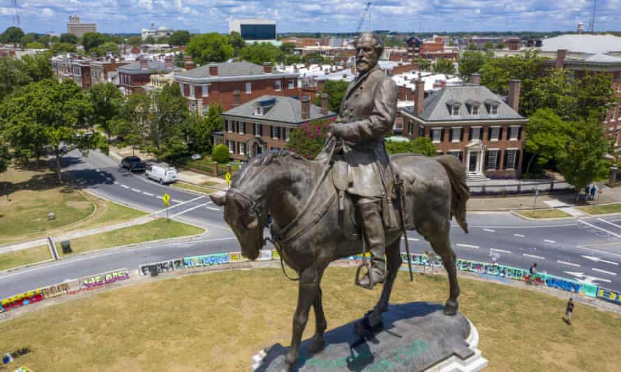 The statue of Robert E Lee towers over Monument Avenue in Richmond, Virginia.