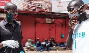 A vendor sells home-made masks at Nakasero market in Kampala, Uganda, on 1 April.