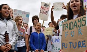 Greta Thunberg, center, and youth activists protest outside the White House on 13 September.