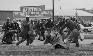 State troopers beat civil rights protesters in Selma, Alabama on 7 March 1965.