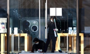 South Korean workers clean an Apple store in Seoul, South Korea, 16 March 2020.