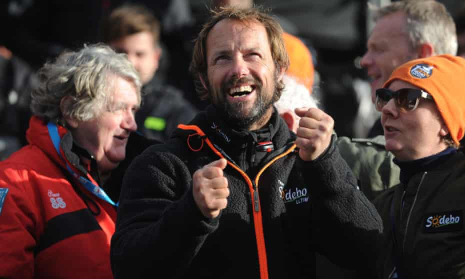 Thomas Coville (centre) reacts as he arrives in Brest.