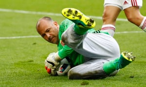 Gabor Kiraly, wearing his muddy tracksuit bottoms, gathers the ball during Hungary's 2-0 win over Austria at Euro 2016