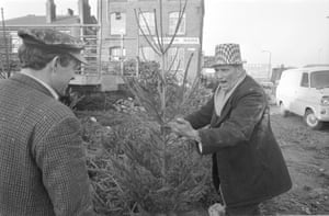 Christmas trees at a Manchester market, 1971 (Archive ref. GUA-6-9-2-1-2-1466). 'They're probably having a nice chat together - it makes the picture cheerful.'