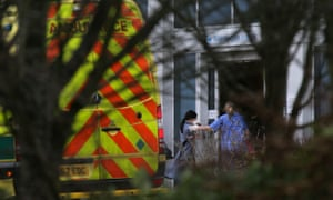 Medical personnel escort British nationals evacuated from Wuhan, China, to Kents Hill Park hotel in Milton Keynes on 9 February.
