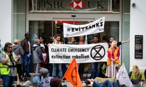Activists outside an HSBC branch.