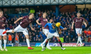 Connor Goldson stoops to score Rangers' second goal.