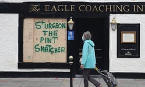 Graffiti on boarding at the Eagle Coaching Inn in Broughty Ferry, Dundee, criticising the Scottish government's ban on indoor pub drinking.