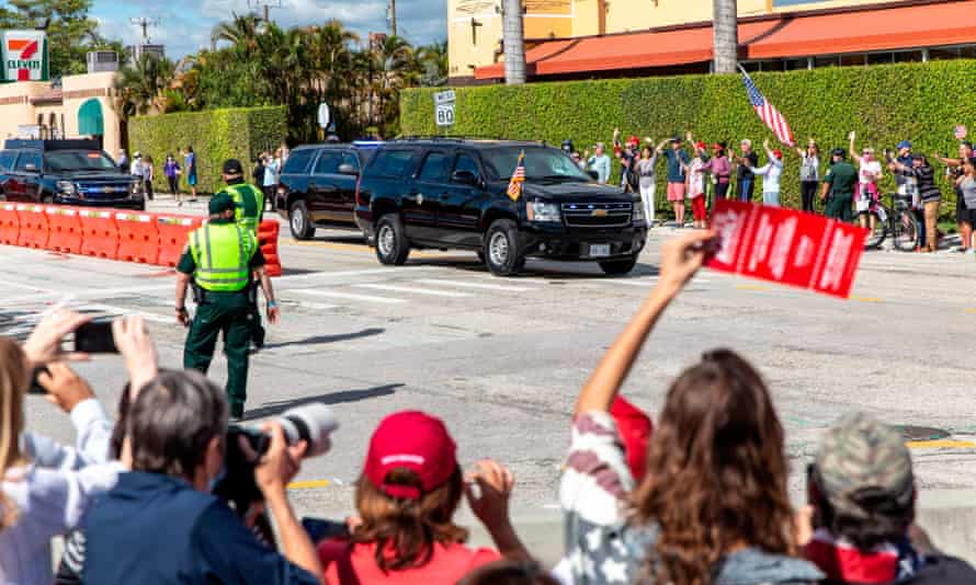 Supporters of Donald Trump wave as his motorcade drives past on the way to Mar-a-Lago in Florida on Wednesday.